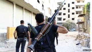 Members of the Free Syrian Army in Damascus suburb of Saqba (file photo)