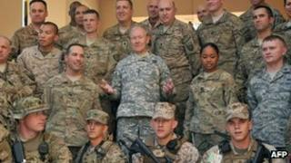 Chairman of the US Joint Chiefs of Staff, General Martin Dempsey (C) poses at the International Security Assistance Force (ISAF) headquarters in Kabul on August 20, 2012