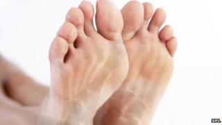 Feet showing superimposed computer image of bones