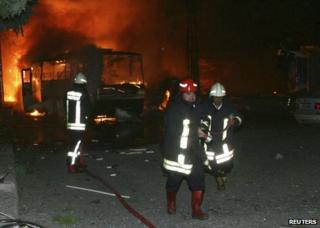 Firefighters tackle a blaze after the bomb blast in Gaziantep, Turkey, 21 August