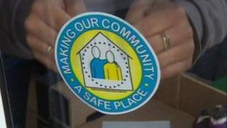 Safe Place Scheme sticker being installed