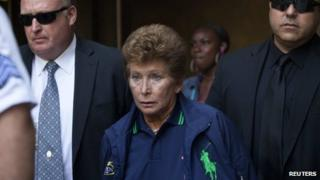 Lois Ann Goodman, 70, is led away from the Manhattan Criminal Court in New York 23 August 2012