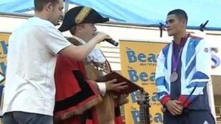 Mayor Nick Webb presents Anthony Ogogo with the coat of arms
