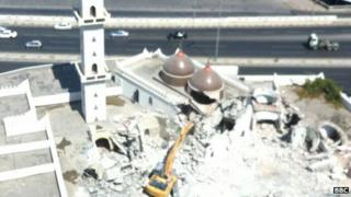 Shrine in Tripoli being attacked with a digger (photo supplied to the BBC by Tripoli resident)