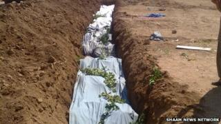 Photo reported to show a mass grave in Darayya