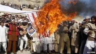 File picture of Afghans burning a US flag during riots over Koran burnings in Jalalabad, Afghanistan 24 February 2012