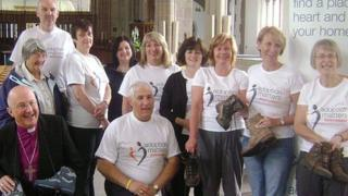 The charity walkers with the Bishop of Blackburn
