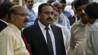 Lawyer Tahir Naveed Chaudhry, centre, waits with other Christian community leaders outside a court in Islamabad on 28 August, 2012.