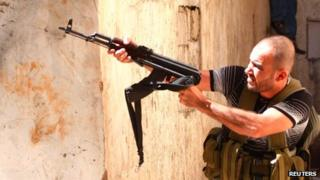 A Sunni Muslim gunman during clashes between Sunni Muslims and Alawites in Tripoli, northern Lebanon, on 22 August 2012