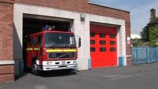 A fire engine leaving a fire station