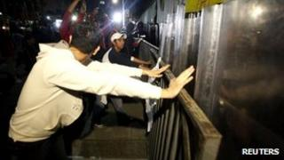 Protesters scuffle with police after the Federal Electoral Tribunal's decision to reject Andres Manuel Lopez Obrador's appeal against the result of the 1 July presidential election