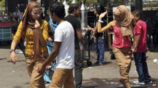 Egyptian women are harassed by men and boys in Cairo. Photo: August 2012