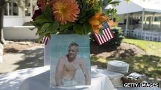 A photograph of Neil Armstrong as a young man is displayed on a table during a memorial service in Ohio. Photo: 31 August 2012