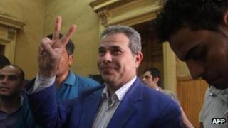 Tawfiq Ukasha gesturing as he arrives in court