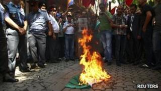 Armenian protesters burn a Hungarian national flag outside the Hungarian consulate in Yerevan. Photo: 1 September 2012