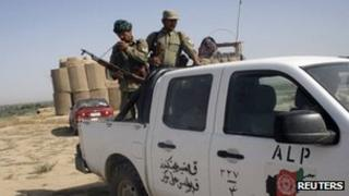 Members of the Afghan Local Police (ALP) patrol at the Char Darah district of Kunduz province