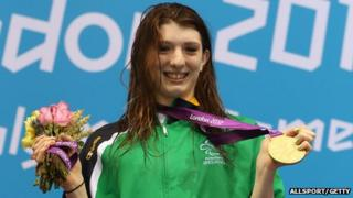 Bethany Firth poses with her gold medal