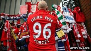 Liverpool supporter pays his respects at the Hillsborough Memorial at Anfield in 2009