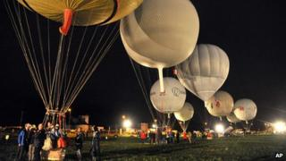 Gas balloons are prepared ahead of the start of the 56th Gordon Bennett balloon race in Ebnat-Kappel