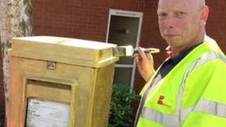 Gold postbox painted for Lily van den Broecke