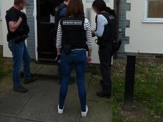 UK Border Agency officers outside address in London