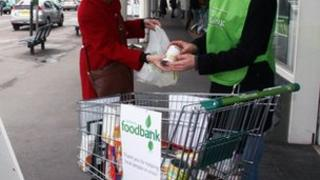A Trussell Trust volunteer collecting donated food