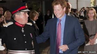 Prince Harry is met by Lord Lieutenant for Greater London David Brewer as he arrives at the WellChild awards ceremony in London on 3 September