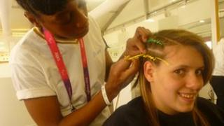Amanda Fowler having her hair braided during the 2012 London Paralympic Games