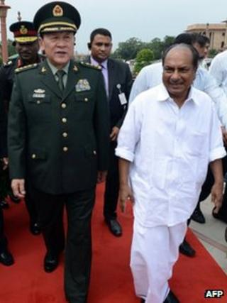 Chinese Defence Minister Liang Guanglie and Indian Defence Minister AK Antony walk after a meeting in Delhi on 4 September 2012