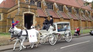 A horse drawn carriage at Dylan Cecil's funeral