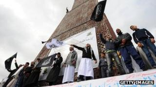 Tunisian Salafists shout slogans claiming an Islamic state as they stage a demonstration on March 25, 2012 in Tunis