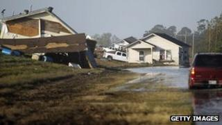 Homes are washed up onto the side of a levee from Hurricane Isaac flooding in Plaquemines Parish on 3 September in Braithwaite, Louisiana