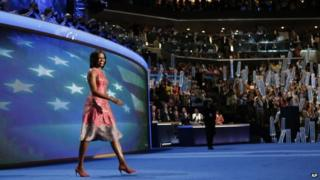 First Lady Michelle Obama waves to delegates at the Democratic National Convention in Charlotte, North Carolina