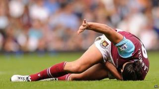 Andy Carroll lies in pain after sustaining an injury