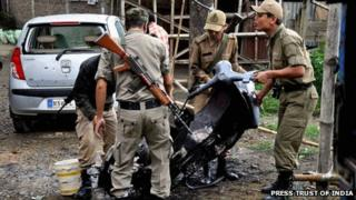 Policemen at the site of the blast in Imphal