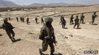 Afghan National Army (ANA) soldiers conduct a patrol outside the village of But Khak on the outskirts of Kabul May 15, 2012.