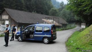 French police car on country road with two policemen