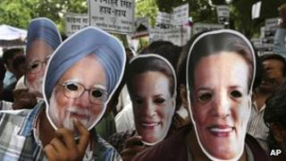 """India""""s main opposition Bharatiya Janata Party (BJP)""""s youth wing """"Bharatiya Janata Yuva Morcha"""" activists wear masks of Prime Minister Manmohan Singh, left, and Congress party chief Sonia Gandhi, right, as they protest a scandal over the government""""s sale of coal fields without competitive bidding in New Delhi, India, Wednesday, Aug.29, 2012."""