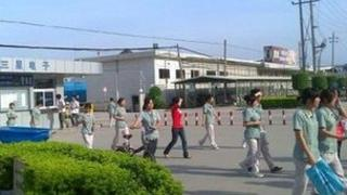 Chinese workers leaving a factory, copyright China Labour Watch