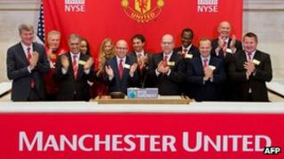 Manchester United executives ring the opening bell at the New York Stock Exchange
