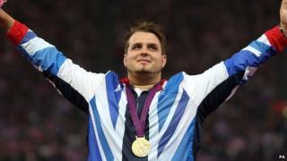 Aled Davies celebrates his medal win
