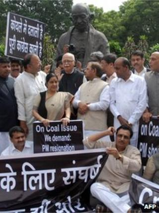 Opposition Members of Parliament, including Bharatiya Janata Party (BJP) senior leader Lalkrishna Advani (C) and Lok Sabha Leader of Opposition Sushma Swaraj (3rd L), participate in a protest in the Parliament compound in New Delhi on September 7, 2012