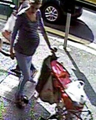 CCTV image of a woman who was outside the shop