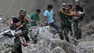 Chinese soldiers rescue children in Zhaotong, Yunnan province