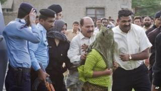"""""""Rimsha"""" is escorted to a helicopter after being released form jail in Rawalpindi, Pakistan, 8 September 2012"""