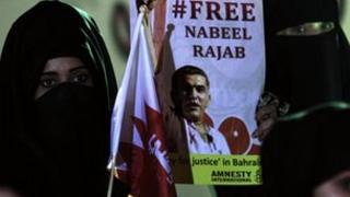 Woman holds poster of Nabeel Rajab in Bani Jamra, Bahrain (09/09/12)