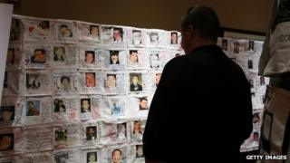 Pictures of loved ones killed in the 9/11 attacks, that were made by family members, are displayed at a preview of the National September 11 Memorial Museum's memorial exhibition in New York City on 10 September 2012