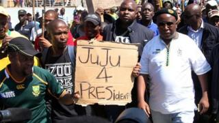 """The former leader of the South African ruling party""""s youth league, Julius Malema (C), arrives on September 11, 2012 at the Gold Fields Driefontein mine in Carletonville,"""