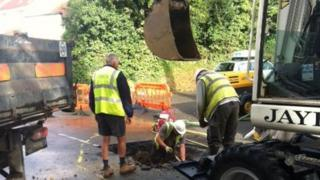 Working on the burst water main on Patier Road