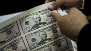A sheet of counterfeit fifty US dollar bills